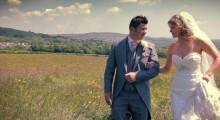 Bride and Groom walking through a meadow- Ashleigh & Rachel - Glyn Clydach Hotel - Wedding