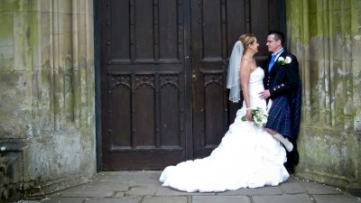 Bride and Groom standing in the doorway of Margam Castle just after getting married in Margam Orangery