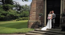 Bride and Groom in embrace outside the church just after getting married.